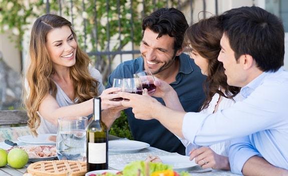 Couples Having Fun Drinking Wine