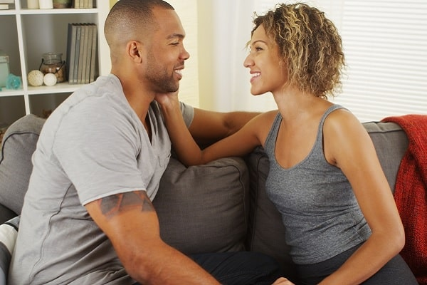 Wife Gently Caressing Husband