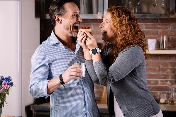 Wife Playfully Feeding Husband