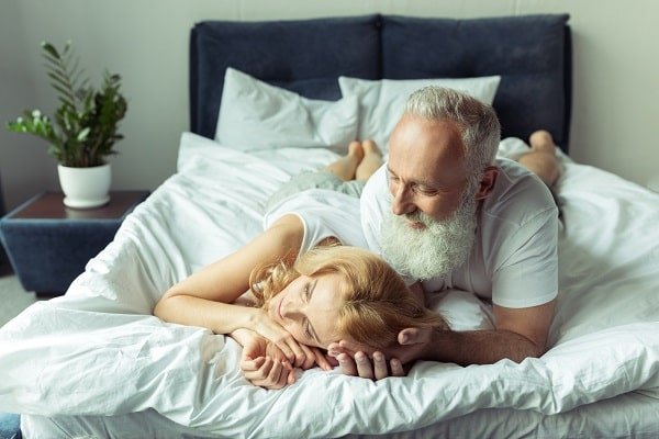 Content Couple Laying in Bed