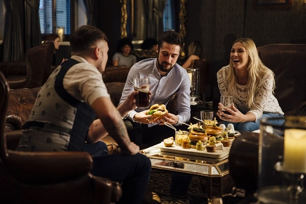 Woman Hanging Out With Group of Men