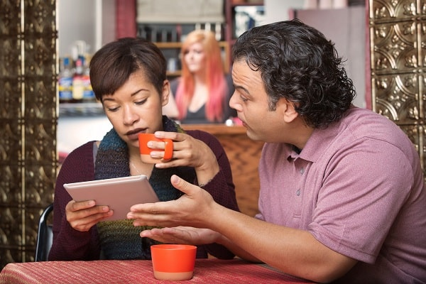 Woman Ignoring Man Trying to Talk to Her